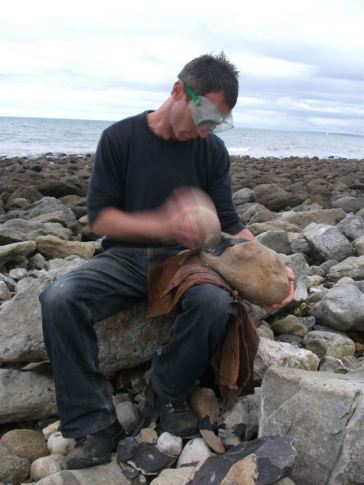 Experimental archaeologist flint knapping