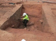 Re-cut ditch containing Roman pottery and tile.