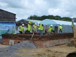 Building the cob walls. Photo by Avalon Marshes Centre.