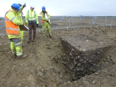 Stone in re-cut Bronze Age enclosure ditch